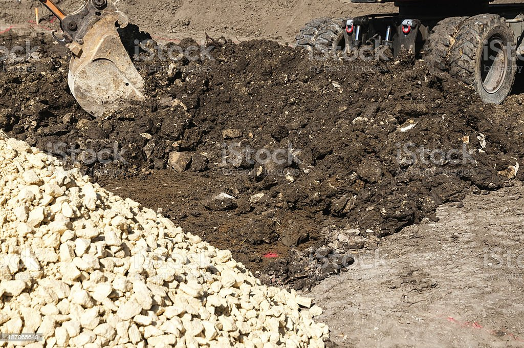 Excavation with excavator on the construction site for a house stock photo