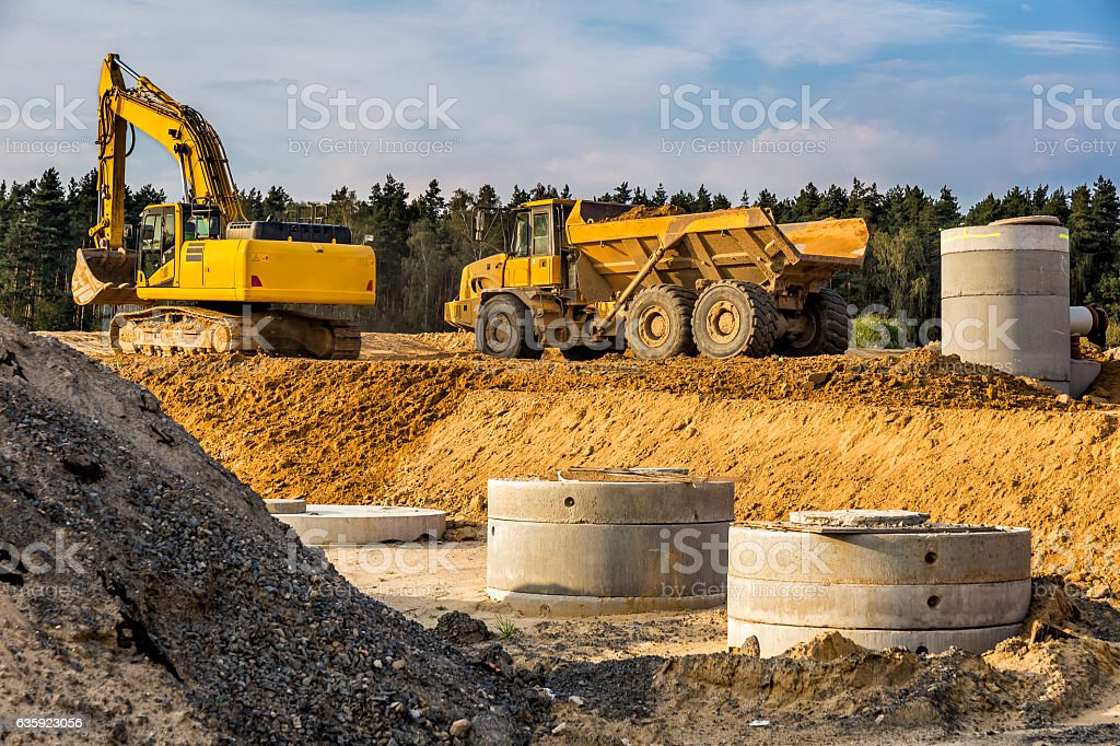 Excavator and dump truck in highway construction S3, Poland stock photo