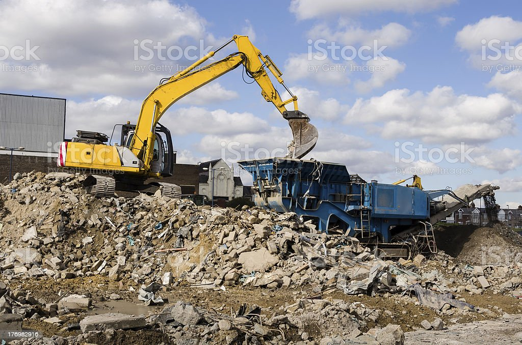Excavator and Rubble Crusher stock photo