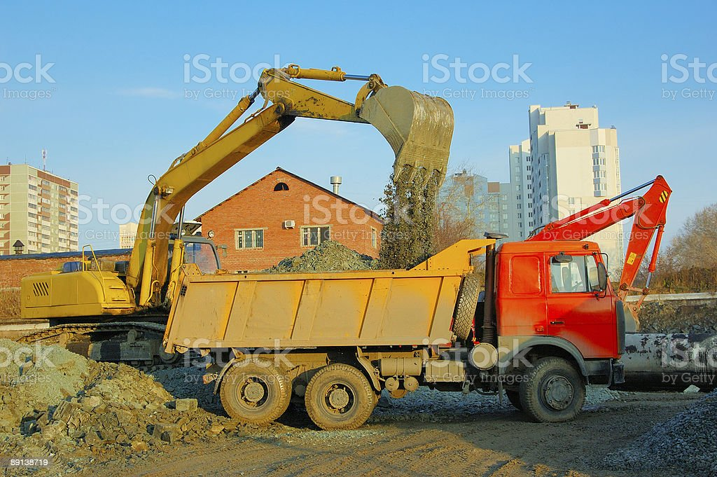 excavator and truck move earth royalty-free stock photo