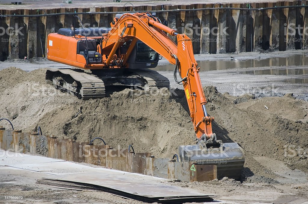 Excavator at a construction site royalty-free stock photo