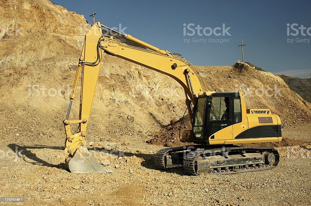 Excavator at open pit mine royalty-free stock photo