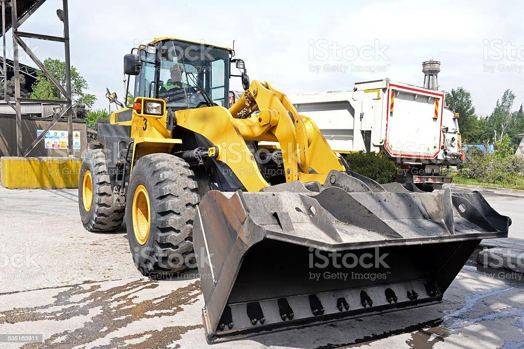 Excavator at parking lot stock photo