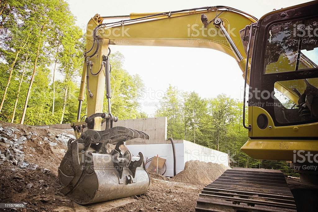 Excavator at residential construction site stock photo
