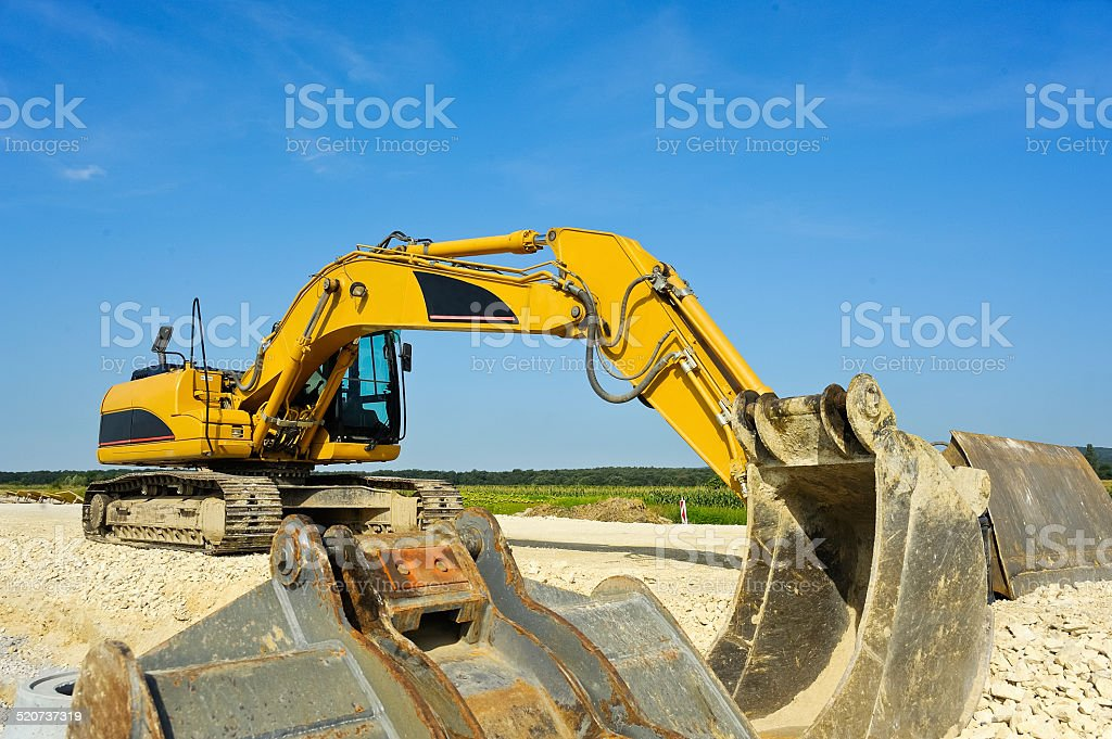 Excavator at road construction stock photo