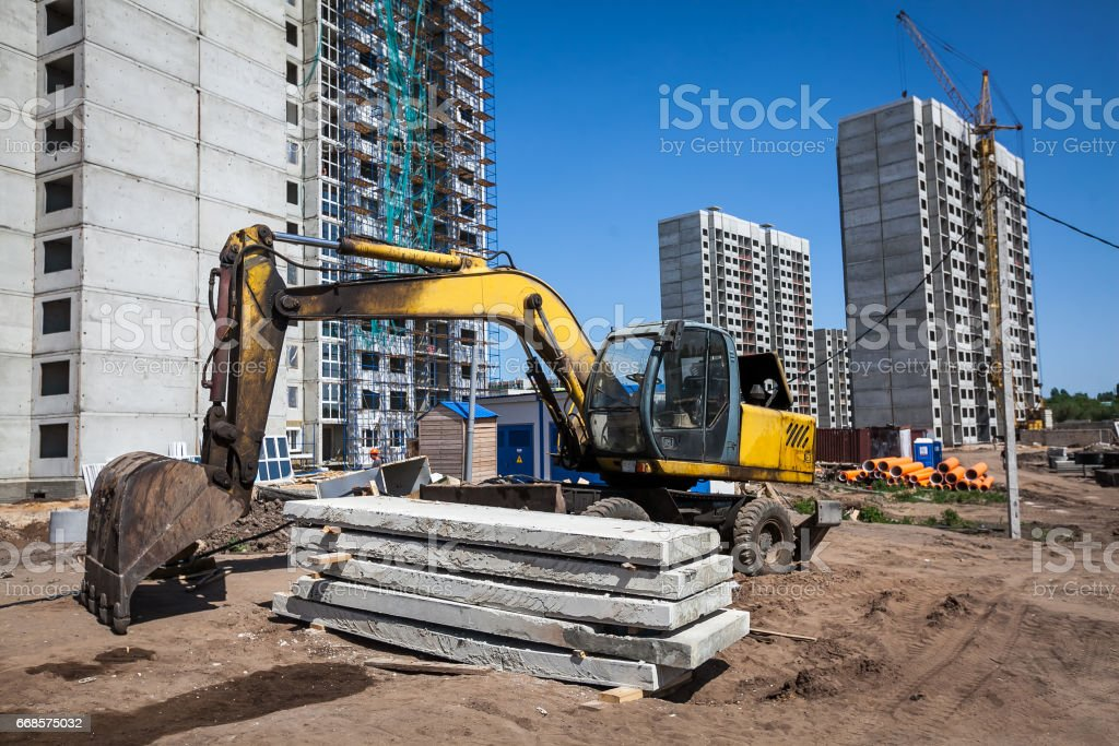excavator at sandpit during earthmoving works stock photo