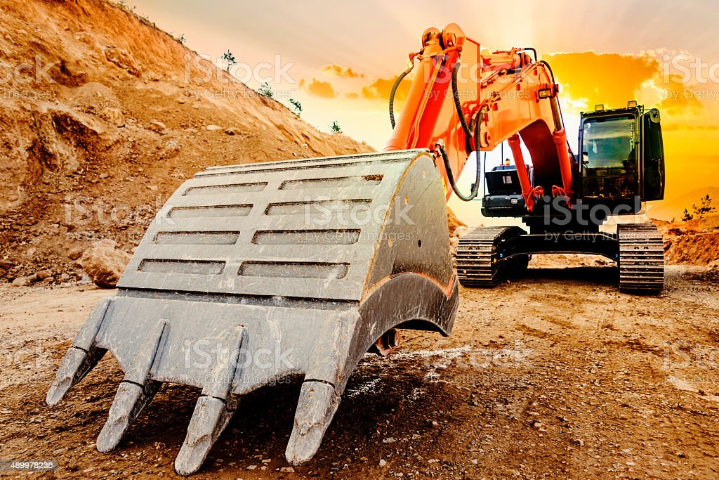 Excavator at Sunset stock photo