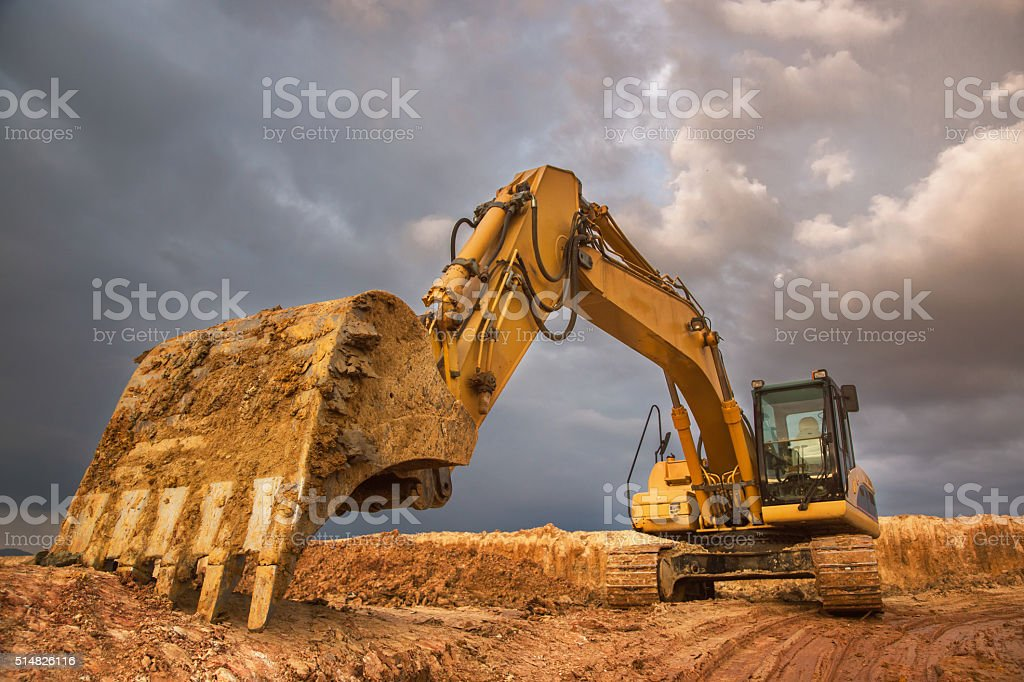 Excavator at sunset stock photo