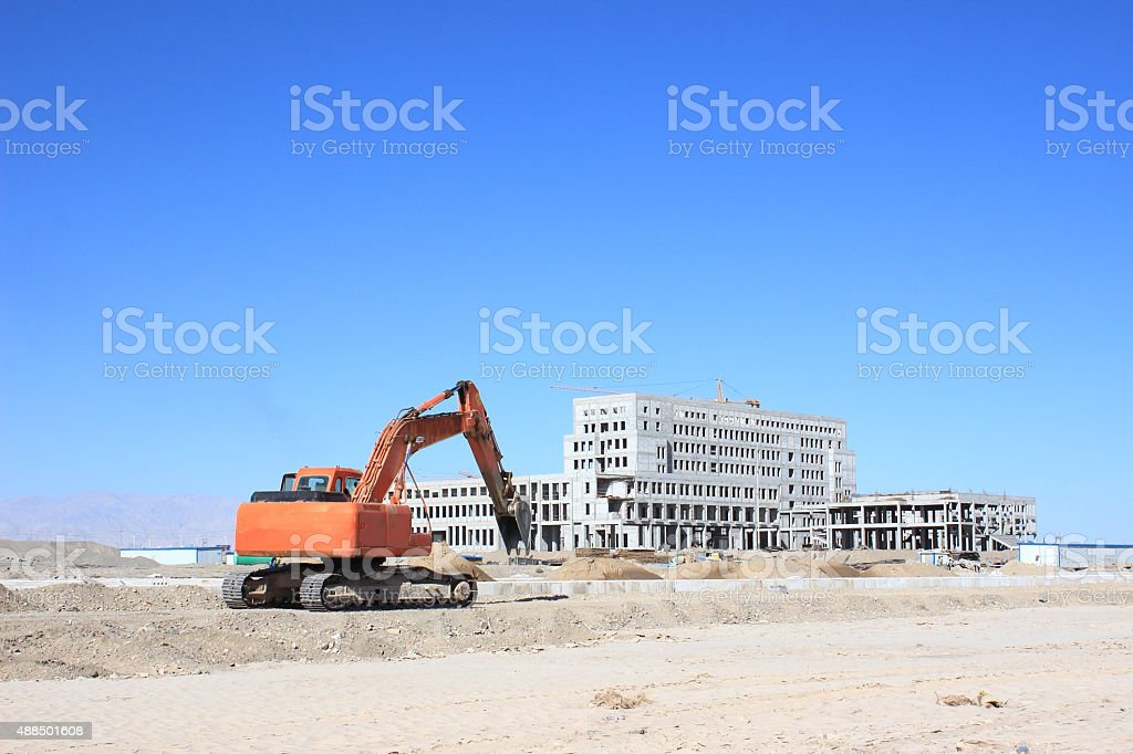 Excavator at the construction site stock photo