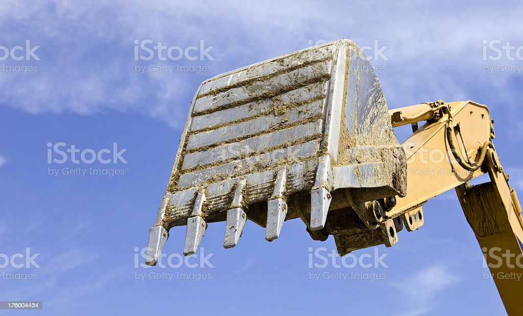 Excavator Bucket across the Blue Sky royalty-free stock photo