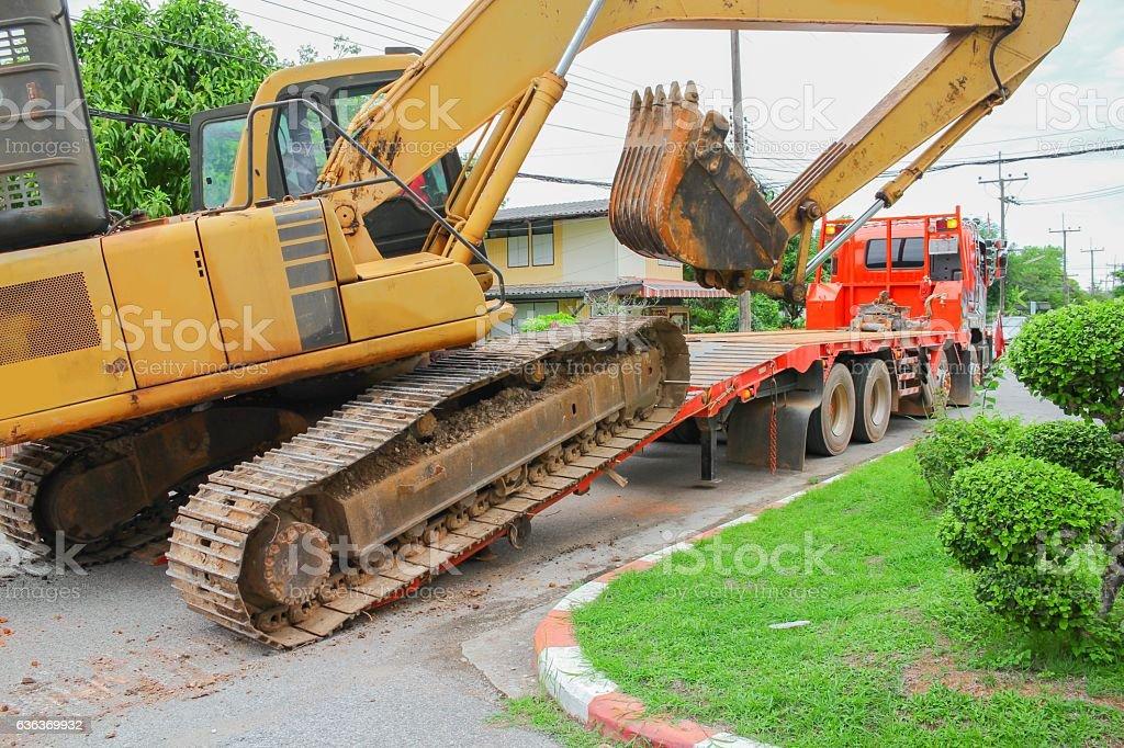 Excavator, bulldozer moving to construction site stock photo