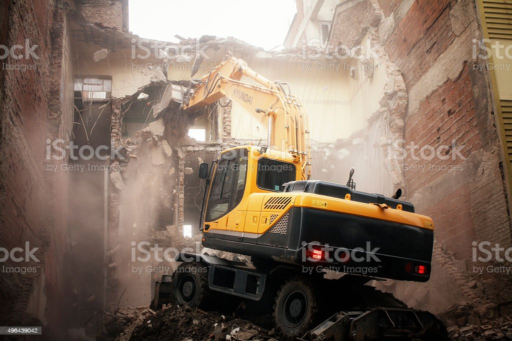 excavator demolition stock photo