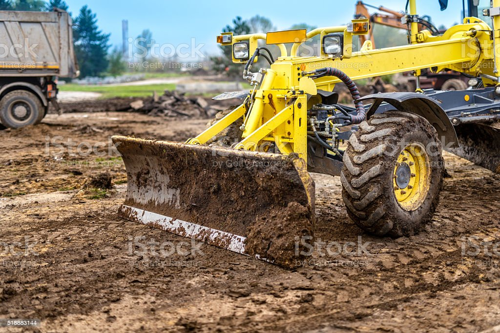 Excavator, dumper truck and bulldozer working stock photo