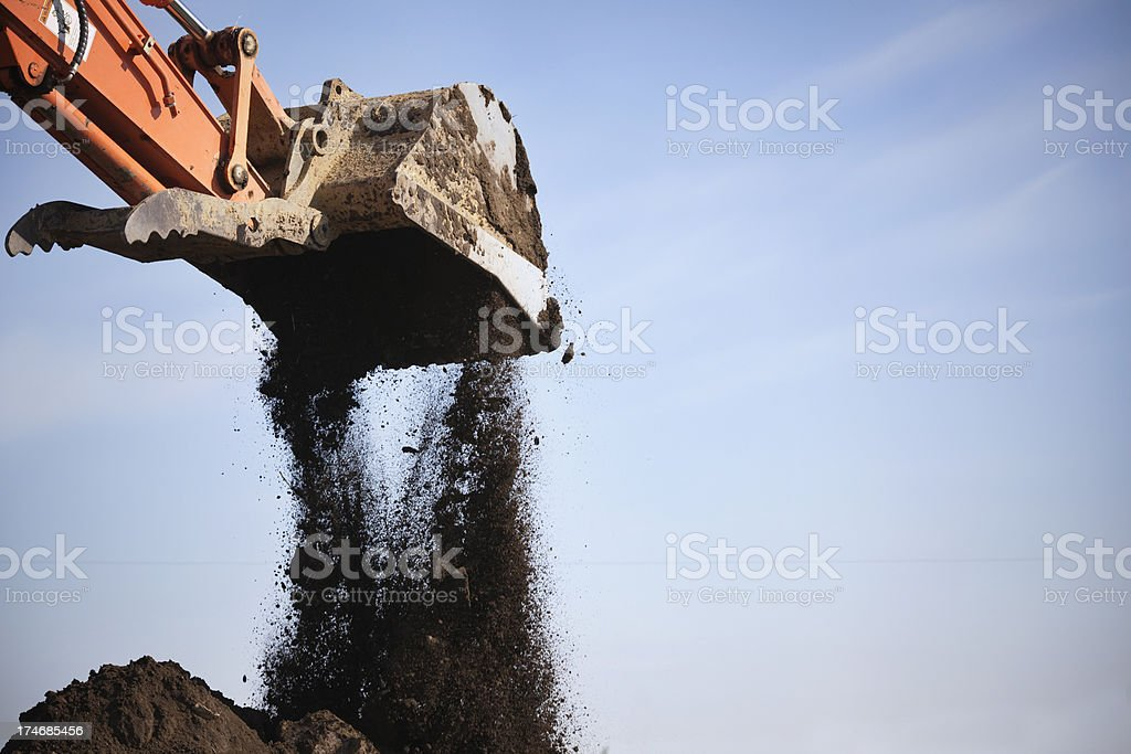 Excavator Dumping Dirt royalty-free stock photo