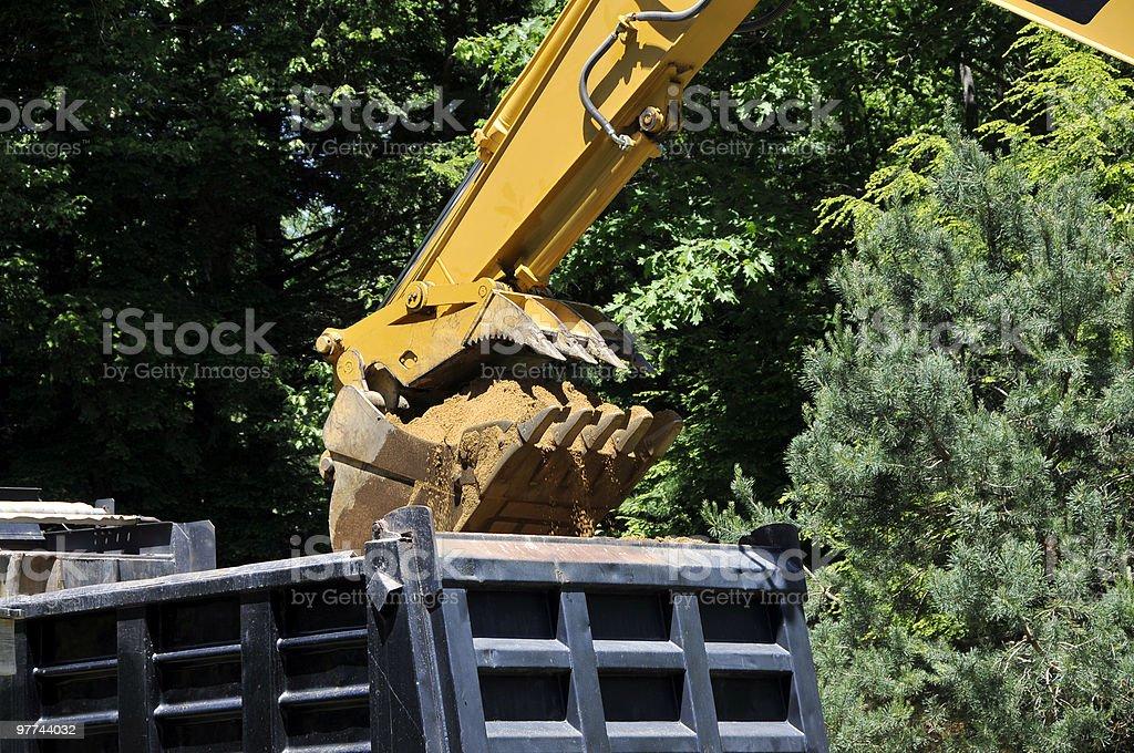 Excavator Empties Dump Truck royalty-free stock photo