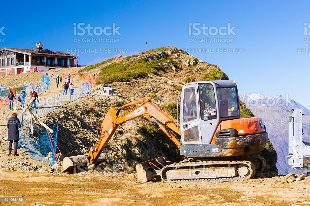 Excavator Hitachi in mountains, Krasnaya Polyana, Sochi stock photo