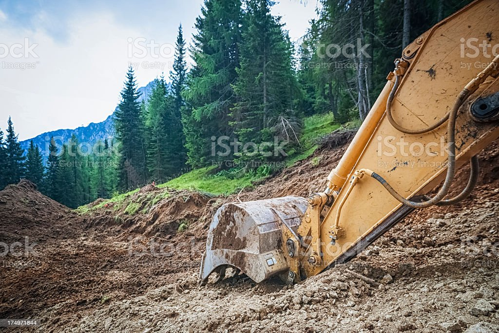 Excavator in a construction site stock photo