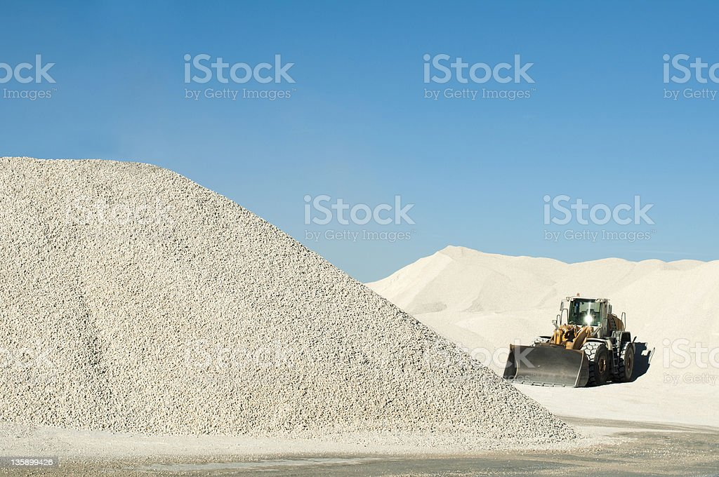 Excavator in a limestone quarry stock photo
