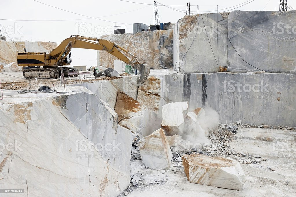excavator in a marble quarry royalty-free stock photo