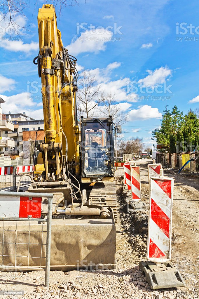 Excavator in a new road construction stock photo