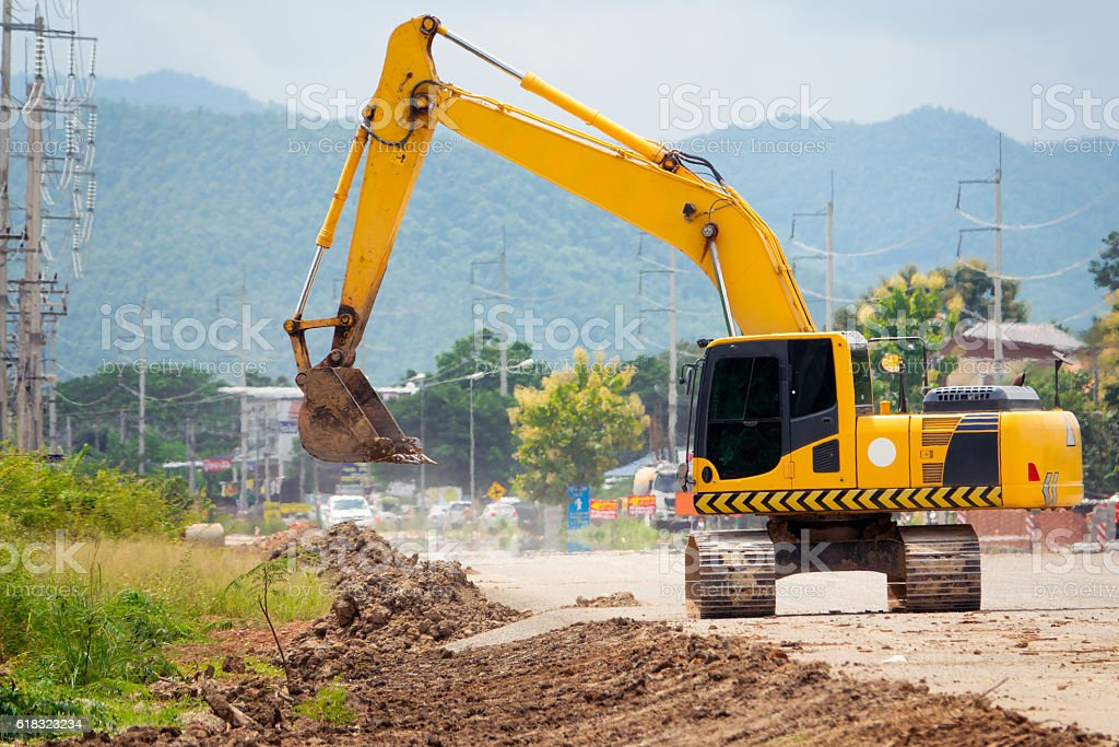 excavator in action stock photo