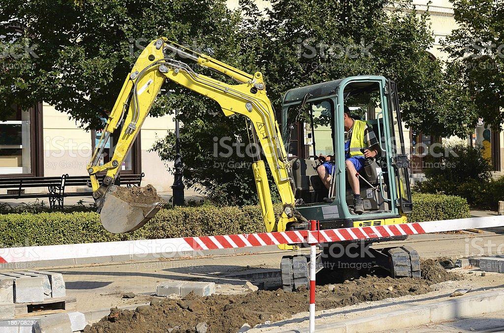 Excavator in construction stock photo