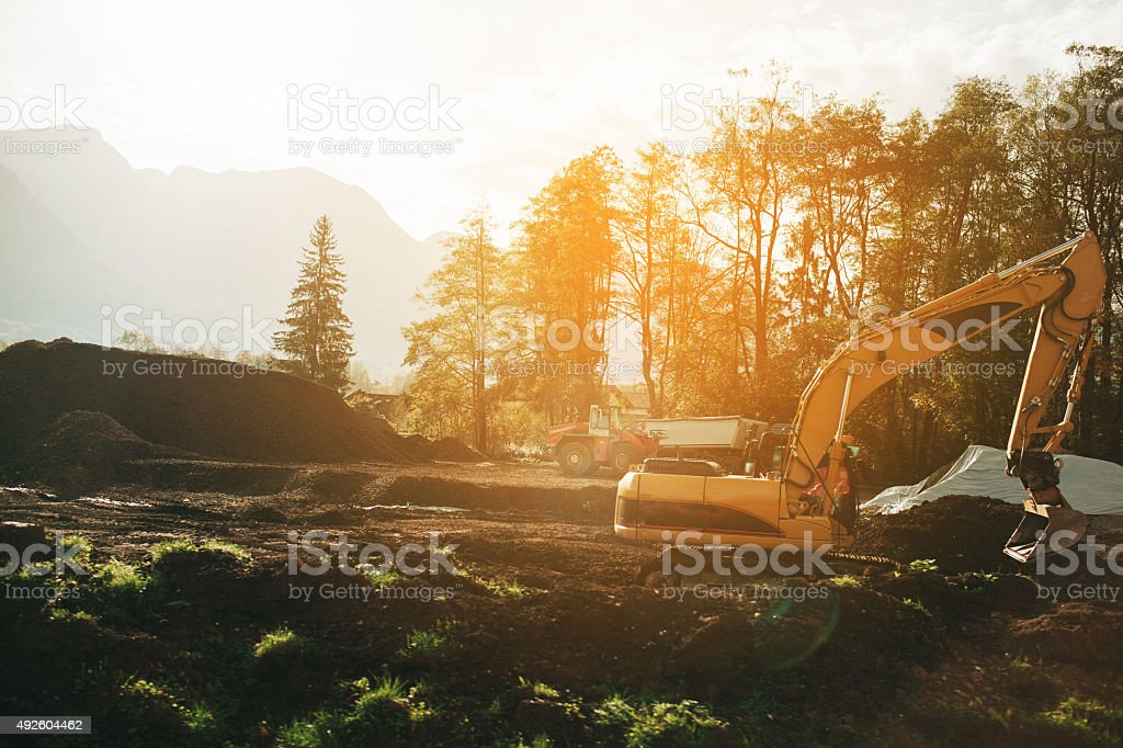 Excavator in forest stock photo