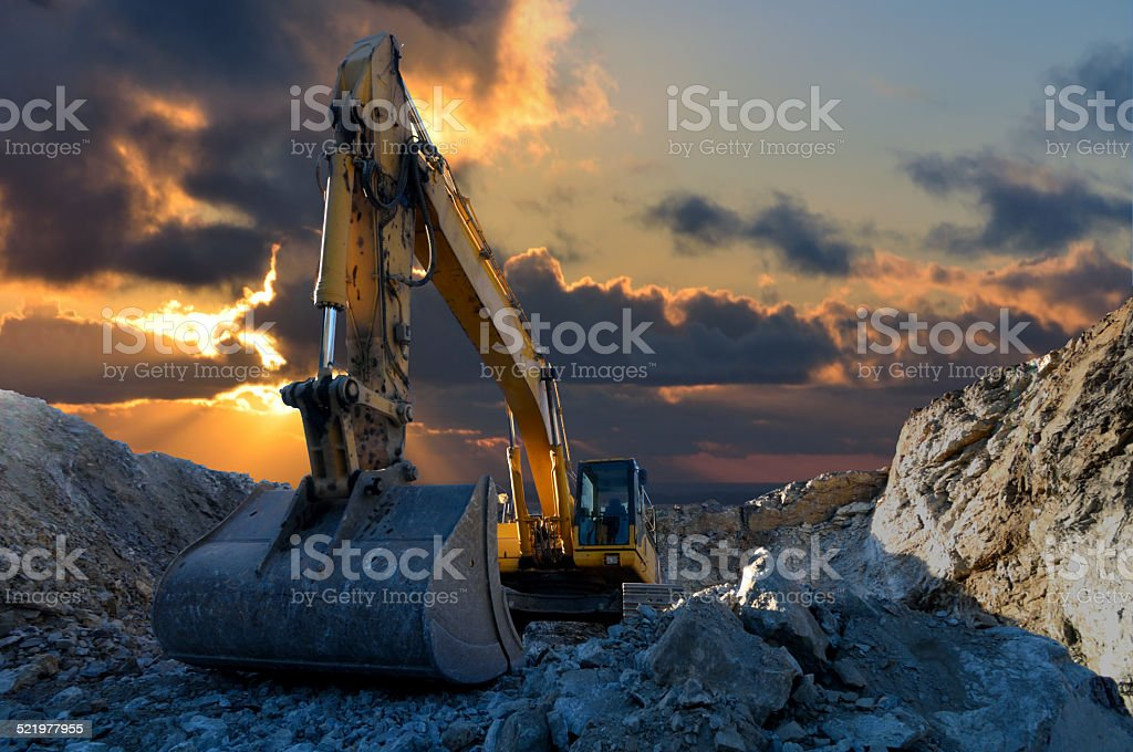 Excavator in Stone Quarry stock photo