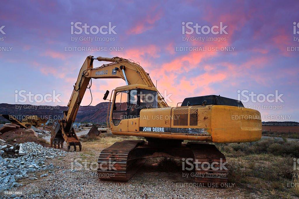 Excavator in Sunrise stock photo