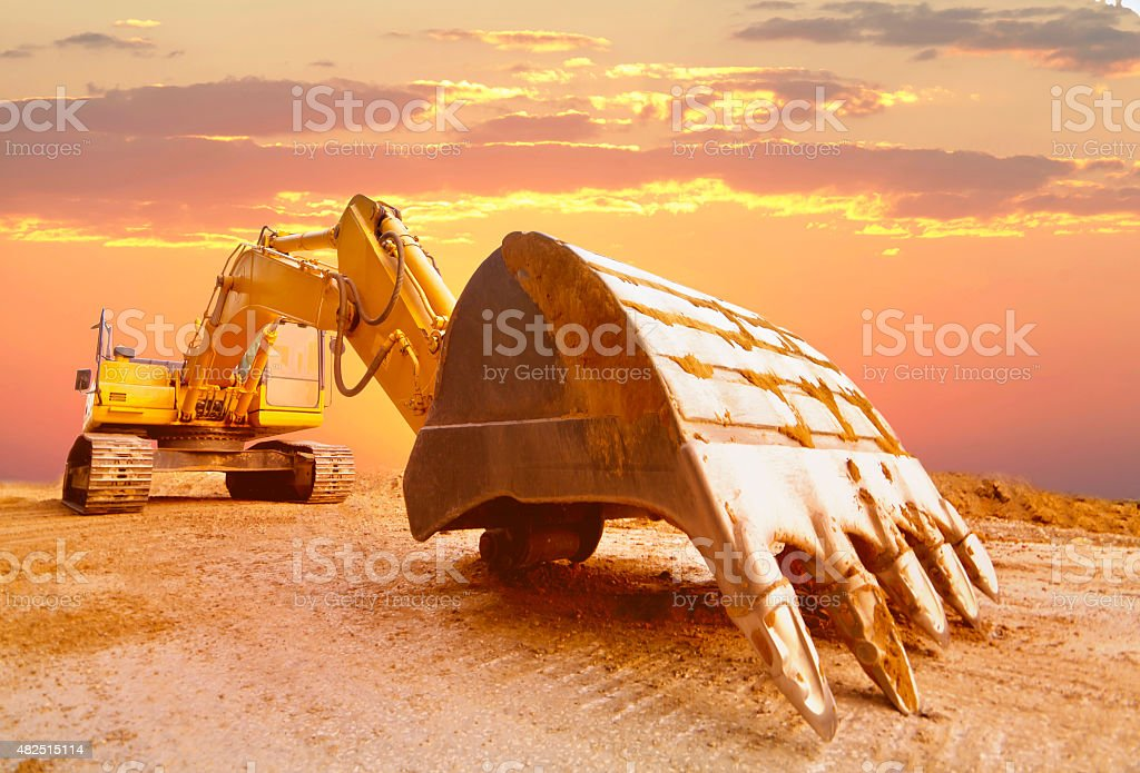 Excavator in sunset light. stock photo