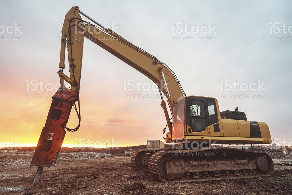 Excavator in Sunset royalty-free stock photo