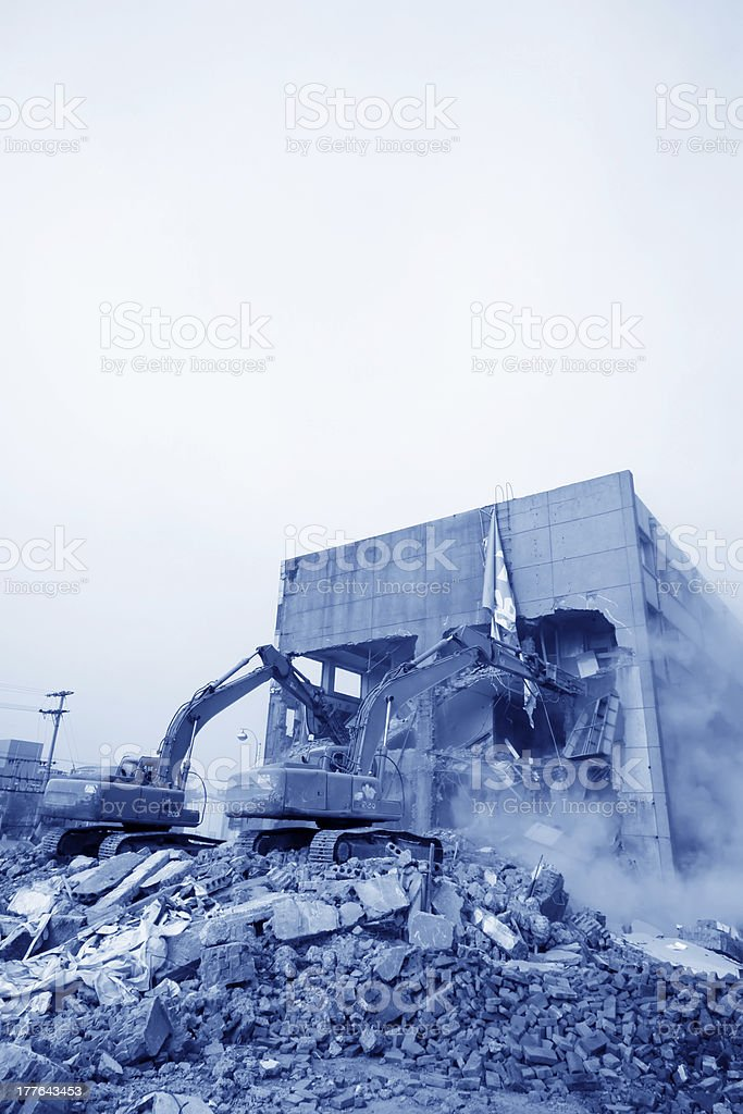excavator in the construction debris clean up site royalty-free stock photo