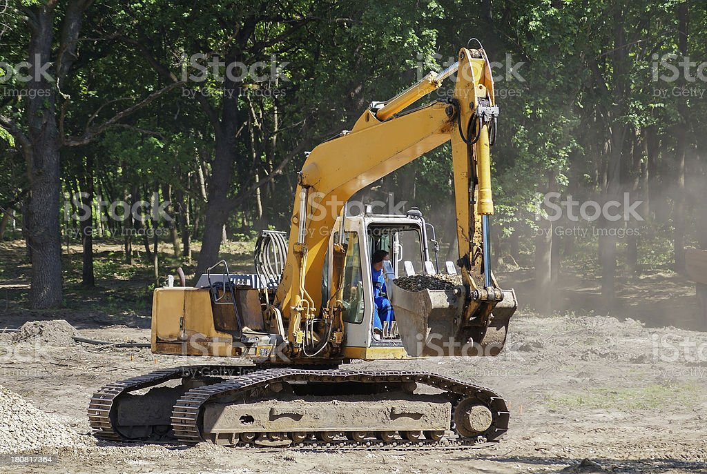 excavator in the woods stock photo