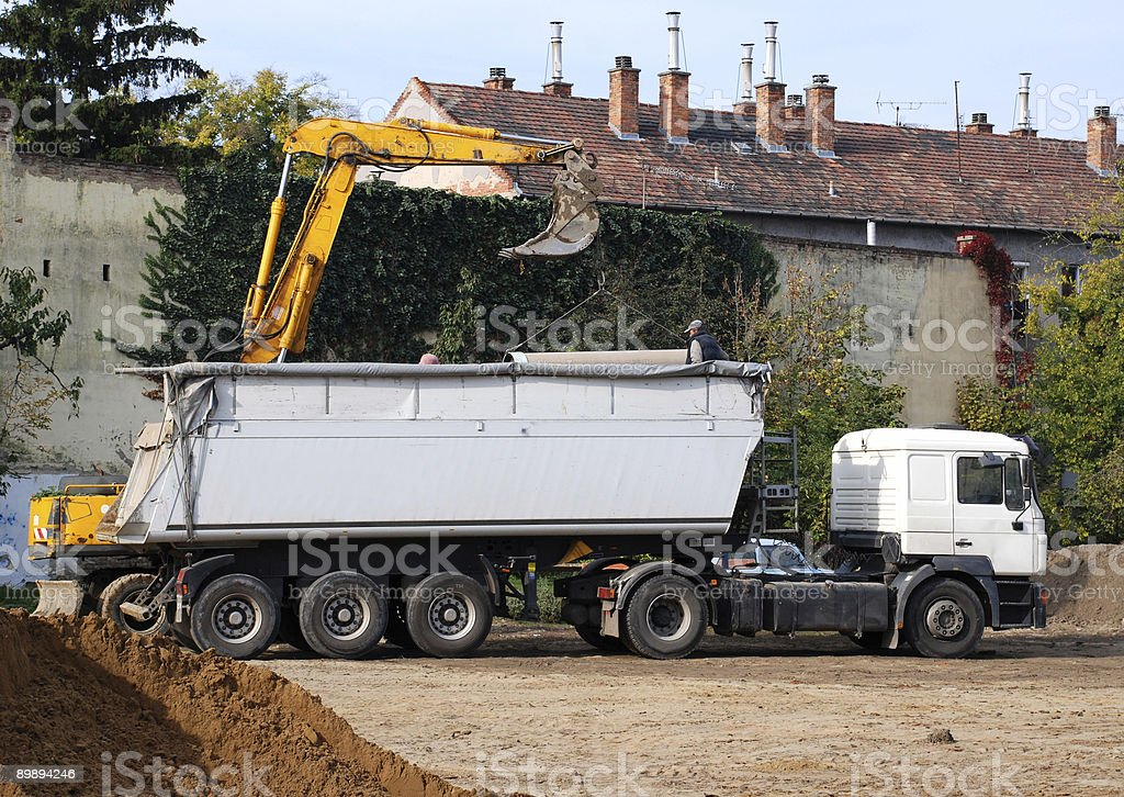 excavator is loading a truck royalty-free stock photo