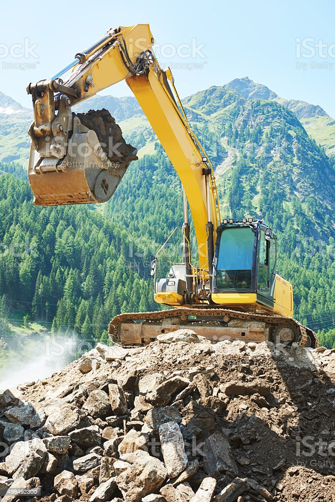 excavator loader machine at construction site stock photo