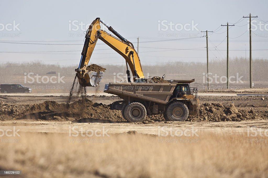 Excavator loading Dumptruck royalty-free stock photo