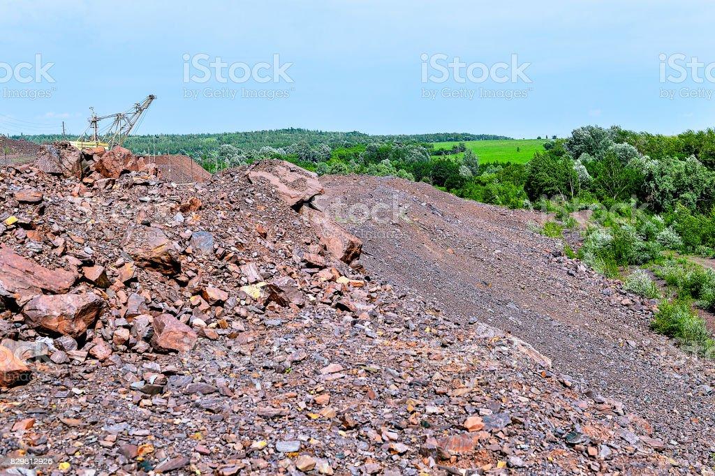 Excavator machine at excavation earthmoving work in quarry stock photo