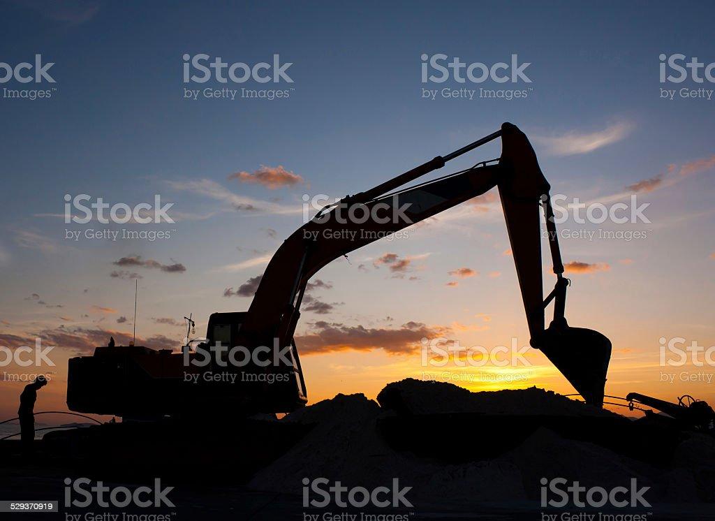 excavator machine doing earthmoving stock photo