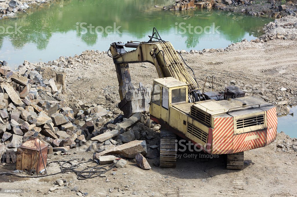 Excavator machine doing earthmoving work stock photo