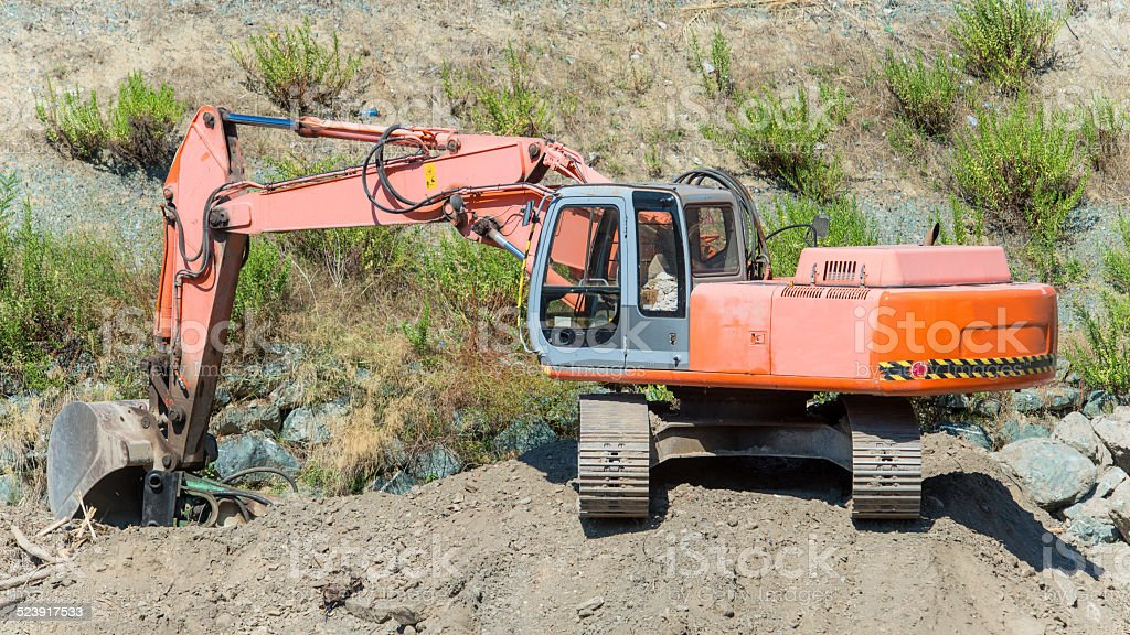 Excavator on construction site royalty-free stock photo