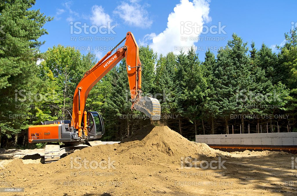Excavator on House Construction Site royalty-free stock photo