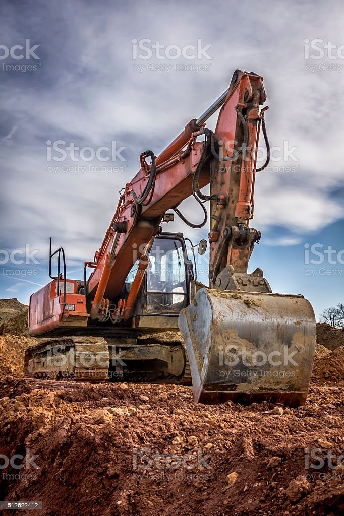 Excavator on the construction of new building stock photo