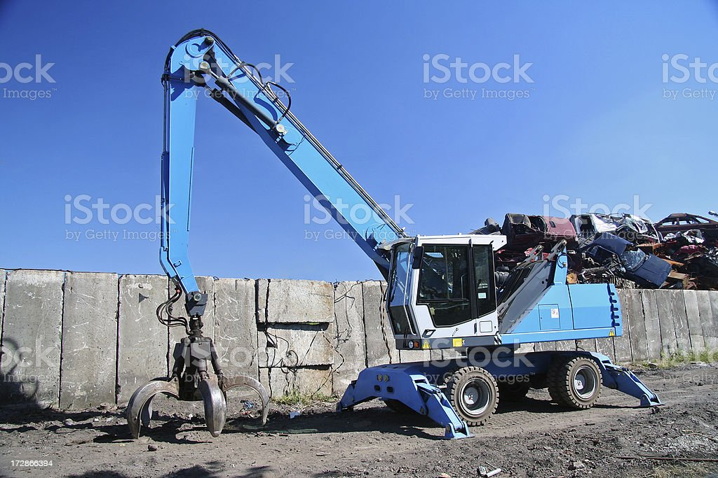 Excavator on the scrap-iron royalty-free stock photo