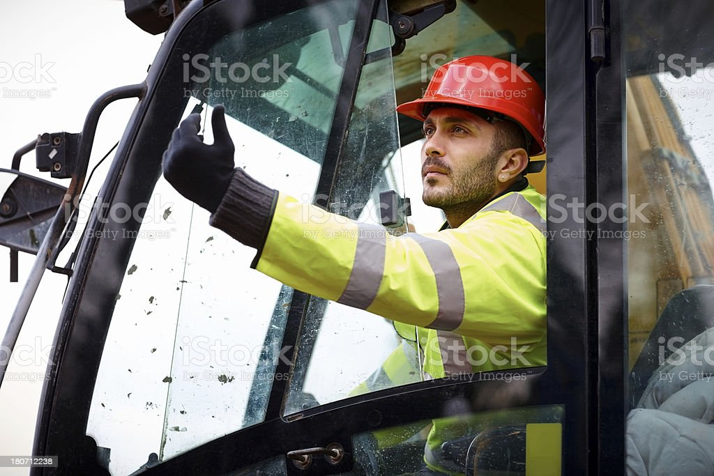 Excavator operator working at construction site royalty-free stock photo
