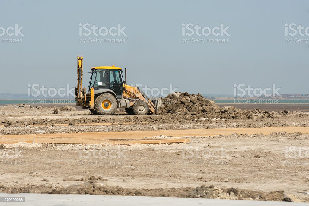 Excavator prepare the site for construction stock photo