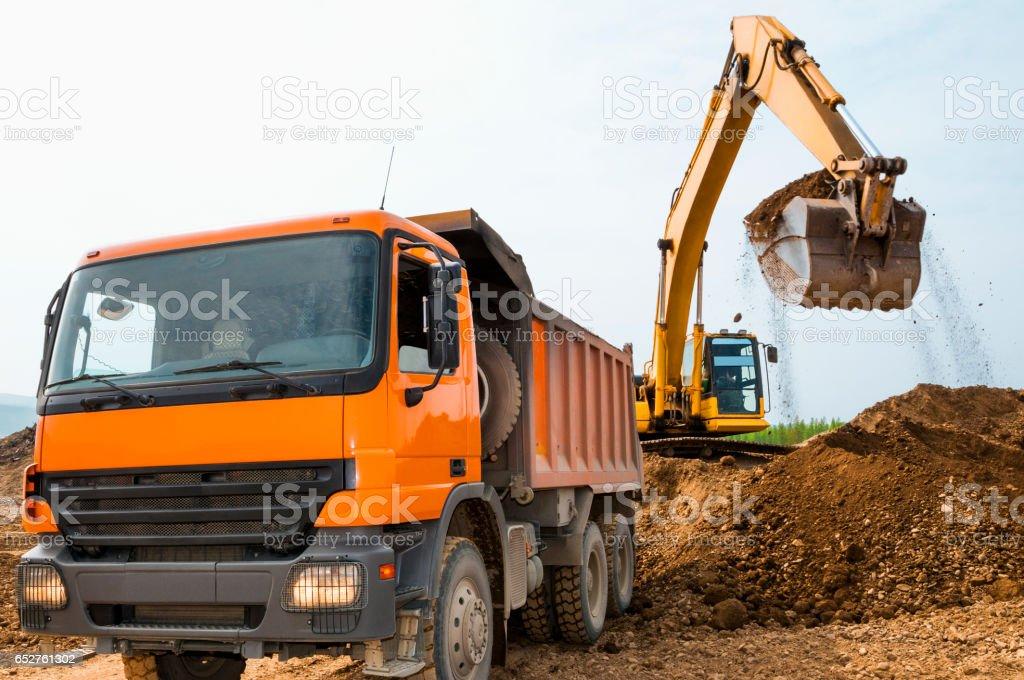 Excavator, tip lorry , earthworks stock photo