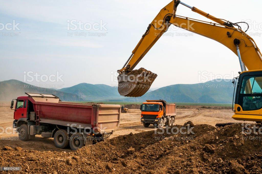 Excavator, tip lorry, earthworks stock photo