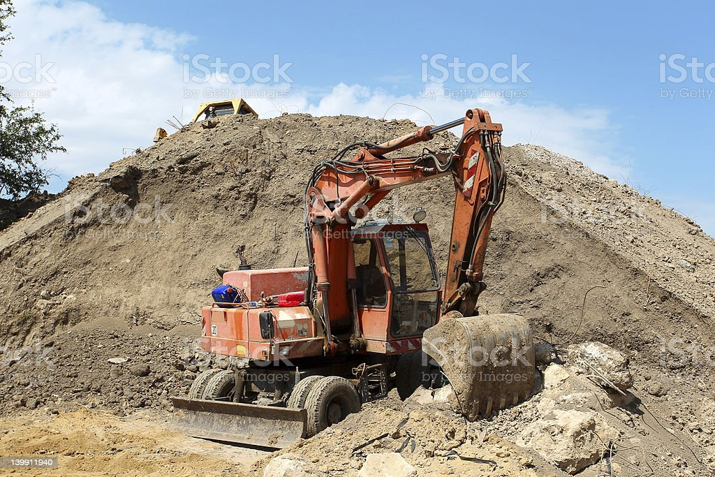 Excavator to dig below the mountain royalty-free stock photo