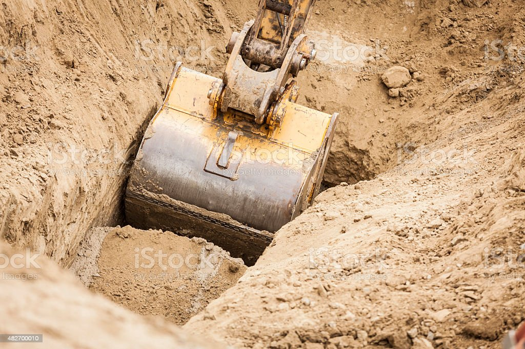 Excavator Tractor Digging A Trench stock photo
