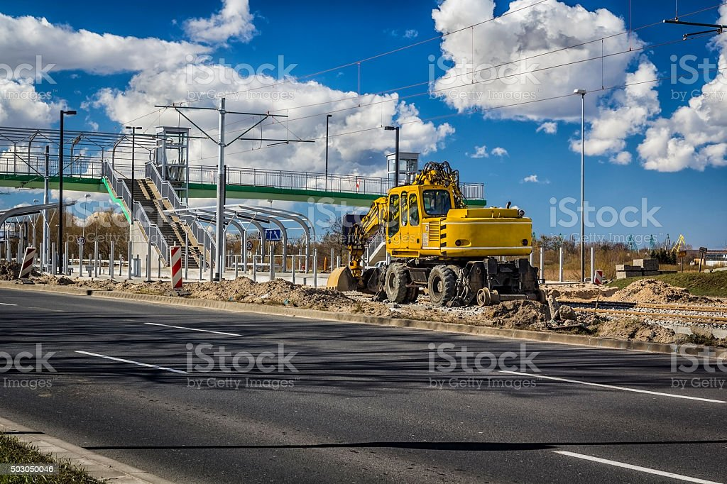 Excavator while working on the tram tracks stock photo